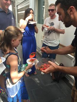 Tour guide Francesco helps our daughter make bruschetta , Robin W - August 2016