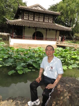 My dad at Suzhou Garden, Cat - August 2012