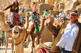 A guy and a camel waving hello at the tourists..., Genesis A - May 2010