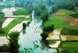 The gorgeous Yangshuo landscape with sprawling rice paddies and bamboo rafting on the river - May 2012