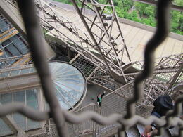 Taken by my husband on his way down from the second level. I attempted to walk up but my vertigo kicked in and I had to go back down. That's me waving from the first level! , Garry M - June 2013