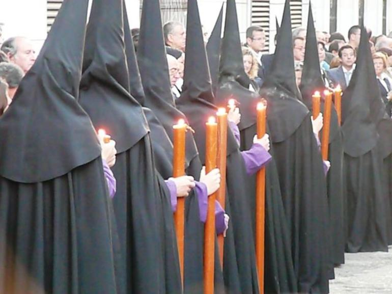 Row of nazarenos penitents - Seville