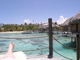 Relaxing on the balcony of my overwater bungalow at Tikehau. , Tighthead Prop - December 2010