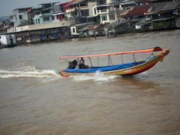 Lots of these drove past us on the river cruise back to Bangkok. , Deana J - November 2013