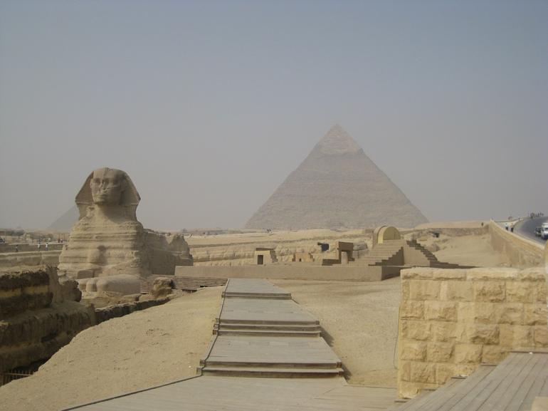 The Sphinx with The Great Pyramid - Cairo
