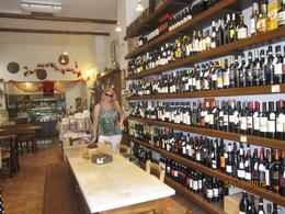 No food tour thru Florence is complete without some wine! This is Leslie from California and the owner of shop behind her. , sharon m - August 2014