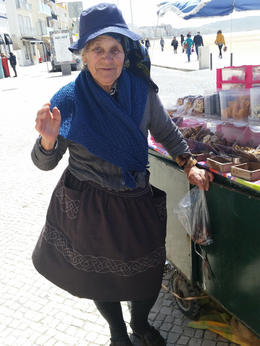 This fish monger wore 6 skirts at once. We bought dried dates from her. , sheryl i - June 2017