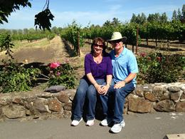 Sitting on a stone wall overlooking the vineyard. , Jim - May 2014