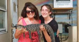 My daughter Kara and I got to hold an alligator after the show! , Heather A - September 2014