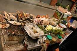 Variety of fried fish for sale from roadside vendor on streets of Bangkok - June 2011