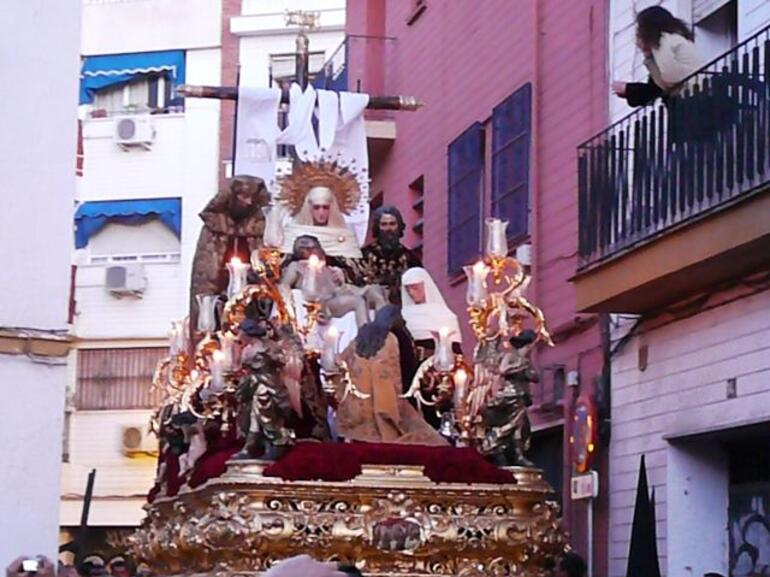 Descent of the cross in a narrow street -