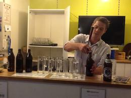 Iain gets our evening off to a start at the Radius tour office with a beer and a toast! , CJ - April 2013