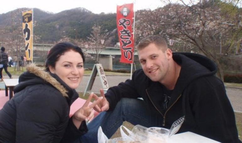 Enjoying a meal by the Kintai bridge -