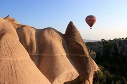 Hot air balloons drift through the valleys around Cappadocia, Peter - October 2010