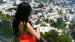 My wife Yelena overlooking the city of Positano from a panoramic rest stop high up on the mountain. , Richard R - August 2014