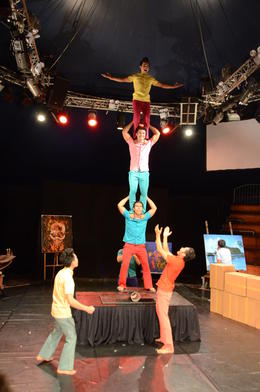 Part of the balancing act that excited the audience. The young chap on top was quite the entertainer, as were all the young people in this show. Notice the artist in the background, and the ... , Gary M - January 2015