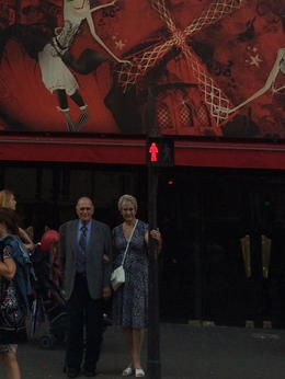 Mom and Dad outside the Moulin Rouge , ready to go in for the show , 121 - August 2014