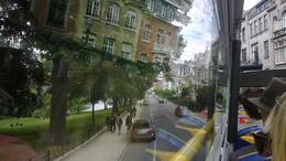 A bord du bus : Photo insolite d'une rue de Bruxelles avec le reflet des maisons dans la vitre. , Isabelle C - June 2014