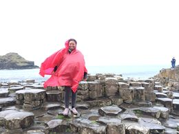 I am at Giant's Causeway with my very useful rain poncho. The wind was pretty wild. , Alyson T - May 2015