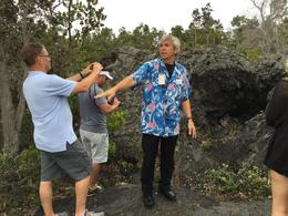 our tour guide was explaining how the volcanoes erupted and taught how to classify the lava rocks. , AMMARIT B - December 2014