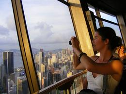 Me taking a photo of my sister taking a photo from the revolving restaurant, 66 floors up!, Kathryn P - August 2009