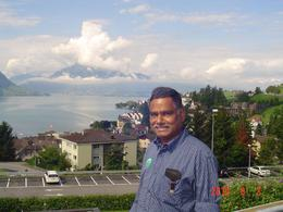 KG at a bus terminal on the way to Mount Pilatus with the lake in the background, Kaliappan G - August 2010