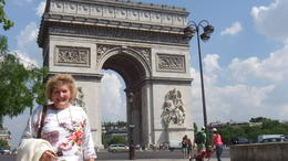 My wife in front of the Arc De Triomphe. Just down the street is the Champs Elysees. , Ange - June 2012