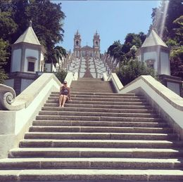 Despite the summer heat, I had to stop and get a photo taken on the steps leading up to the Bom Jesus De Braga. , Raelene W - July 2015