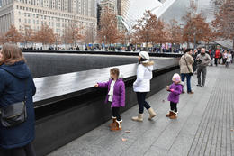 Wife and kids paying tribute to 9/11 victims at the memorial site , marcusdburnette - December 2016
