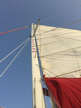Raising the Sail on our Sunset Cruise - July 2015