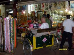 Trishaw ride through the narrow lanes of the night markets in Singapore's China Town., John N - April 2008
