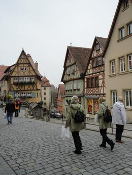 Walking towards the town square. Loved all the flowers and the Bavarian architecture. It was a bit rainy for the first part of the day but it didn't hamper anyone's enjoying this quaint little town., Laura B - September 2010