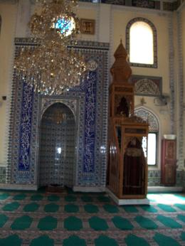 beautiful interior of a small local mosque in Izmir showing tile work and wood carving, as well as chandelier , Linda Abbott T - March 2013