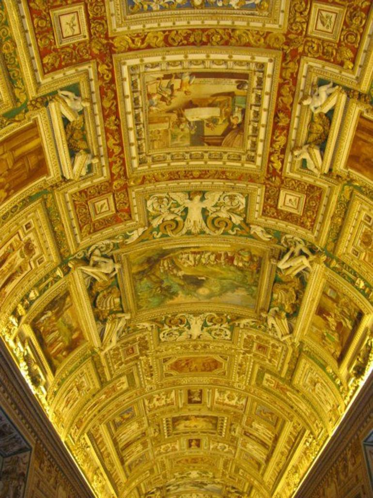 The ornate ceiling in the Map room at Vatican Museum - Rome