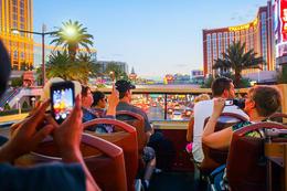 Tourists taking photos just after sunset on the Big Bus Las Vegas Hop-On Hop-Off tour., Viator Insider - December 2017