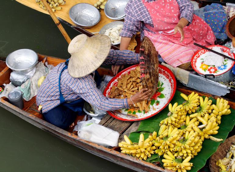 Woman Trading Food at Floating Market - Bangkok