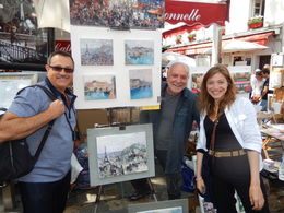 Here is Jeff with Belen and the artist, Walley! Belen gave us very informative hints when looking at the local artists and their work which lead to our purchase! , Scott R - June 2015