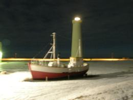 The boat is aground next to the lighthouse. - February 2009
