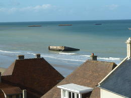 Remnants of large objects dropped in place by the Allies to create a harbour , Herb - October 2012