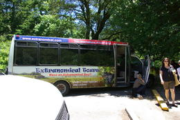 The bus with the hood up 2 hours and 15 minutes into our ordeal. , Susan M - June 2012