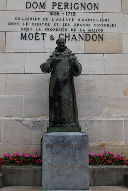 A statue of the monk responsible for discovering the champagne process outside the Moet and Chandon winery. , Jeff & Kathy - July 2012