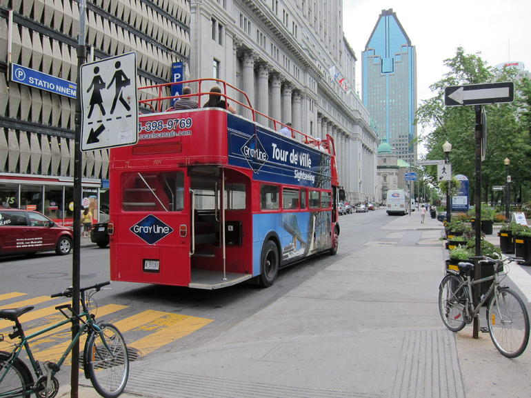 The double decker bus in the point of departure on peel Street. - Montreal