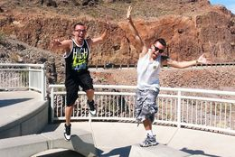 Brandon and Jordan heading back to the tour bus after taking photos atop the Bypass Bridge of Hoover Dam. , Robert T - June 2015