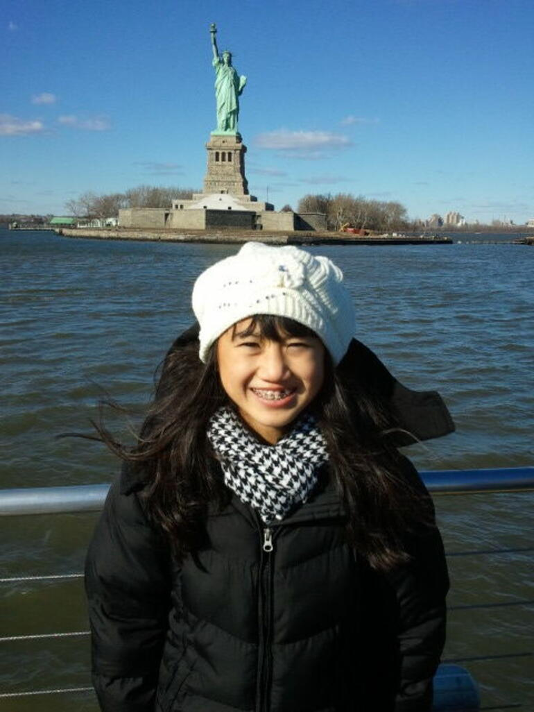 Evelyn Nguyen and the Statue of Liberty - New York City