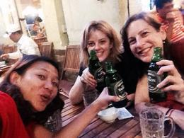 Tour guide Tham (left), Ta (right) and myself (middle) drinking Saigon Beer at our last stop for the evening. , Kylie R - October 2014