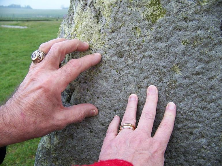 Touching the stones at Stonehenge - London