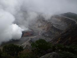 Poas Volcano: Once the clouds moved out, we were able to capture this magnificent shot of the crater emitting steam and gases - June 2011