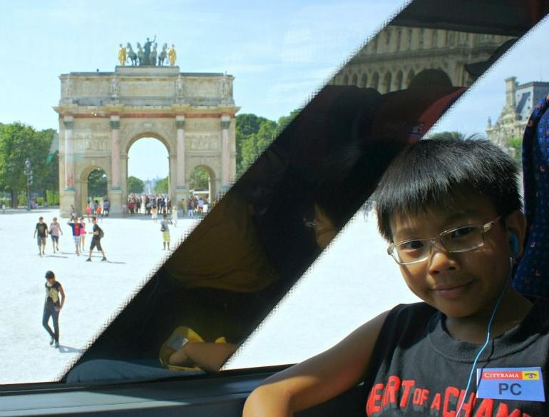 My son enjoying the tour bus ride. - Paris