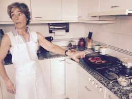 Sonia our teacher and chef teaching us the art of cooking classic paella. , Susan S - July 2015