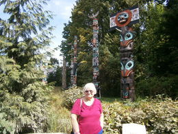 Ann with samples of totems in the background , Ann W - August 2015